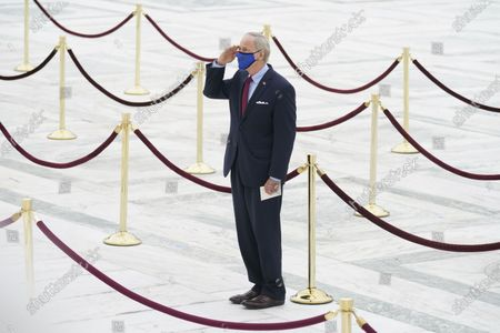 United States Senator Tom Carper (Democrat of Delaware), pays respects as Justice Ruth Bader Ginsburg lies in repose under the Portico at the top of the front steps of the U.S. Supreme Court building, in Washington. Ginsburg, 87, died of cancer on Sept. 18.