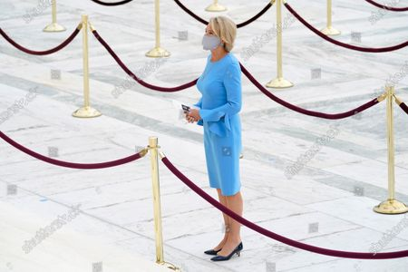 United States Secretary of Education Betsy DeVos pays respects as Justice Ruth Bader Ginsburg lies in repose under the Portico at the top of the front steps of the U.S. Supreme Court building, in Washington. Ginsburg, 87, died of cancer on Sept. 18.