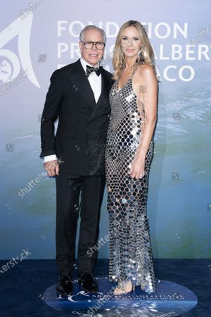 Stock Picture of Tommy Hilfiger and Dee Ocleppo