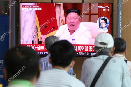 """People watch a screen showing a file image of North Korean leader Kim Jong Un during a news program at the Seoul Railway Station in Seoul, South Korea, . Kim apologized Friday over the killing of a South Korea official near the rivals' disputed sea boundary, saying he's """"very sorry"""" about the """"unexpected"""" and """"unfortunate"""" incident, South Korean officials said Friday"""