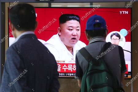 """Stock fotografie na téma People watch a screen showing a file image of North Korean leader Kim Jong Un during a news program at the Seoul Railway Station in Seoul, South Korea, . Kim apologized Friday over the killing of a South Korea official near the rivals' disputed sea boundary, saying he's """"very sorry"""" about the """"unexpected"""" and """"unfortunate"""" incident, South Korean officials said Friday"""