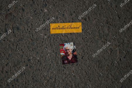 A sticker of Somsak Jeamteerasakul former history lecture and political activist placed on the ground in front of the parliament house during the demonstration. Thousands of anti-government protesters demand the constitutional amendments. Protesters temporarily closed the road in front of the parliament to set up a stage for speeches while, in parliament they held a meeting and voting on constitutional amendments.