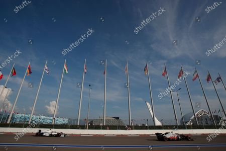 Haas driver Romain Grosjean of France, right steers his car followed by Williams driver George Russell of Britain during the second practice session for the upcoming Russian Formula One Grand Prix, at the Sochi Autodrom circuit, in Sochi, Russia, . The Russian Formula One Grand Prix will take place on Sunday