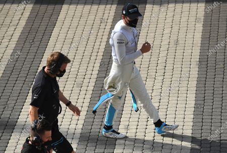 Williams driver George Russell of Britain walks near the paddock prior to the second practice session for the upcoming Russian Formula One Grand Prix, at the Sochi Autodrom circuit, in Sochi, Russia, . The Russian Formula One Grand Prix will take place on Sunday