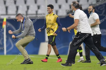 Taawoun's head coach Patrice Carteron (L) celerbates his team's victory during the AFC Asian Champions League group C football match between Al Duhail SC of Qatar and Al Taawoun FC of Saudi Arabia at Education City Stadium in Doha, Qatar, on Sept. 24, 2020.