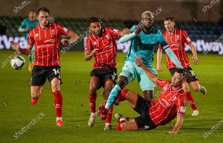 Stock Picture of Lincoln Lewis Montsma tackles Liverpool Origi in the EFL cup