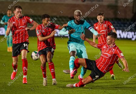 Lincoln Lewis Montsma tackles Liverpool Origi in the EFL cup