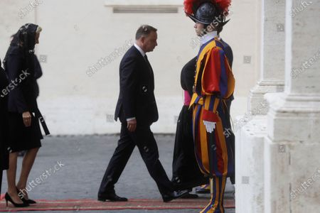 Polish President Andrzej Duda and his wife Agata Kornhauser-Duda arrive at the St. Damaso courtyard to meet with Pope Francis at the Vatican