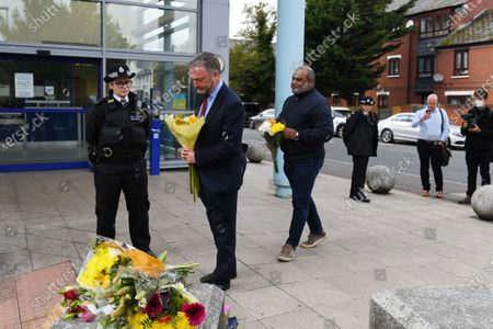 Steve Reed MP for Croydon North lays floral tributes outside Croydon Custody Centre following the death of a police officer