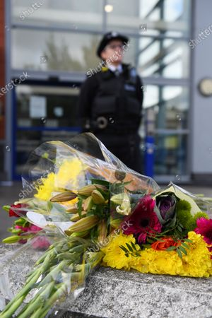 Floral tributes outside Croydon Custody Centre following the death of a police officer