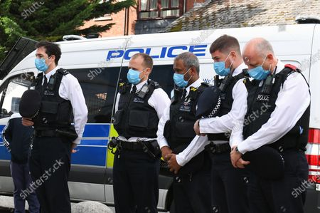 Police officers outside Croydon Custody Centre following the death of a police officer