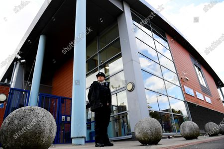 A police officer stands outside Croydon Custody Centre following the death of a police officer