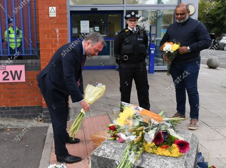 Stock Image of Steve Reed MP for Croydon North lays floral tributes outside Croydon Custody Centre following the death of a police officer