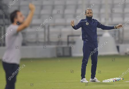 Sepahan FC head coach Moharram Navidkia (R) reacts during the AFC Asian Champions League group D football match between Sepahan FC of Iran and Al Sadd SC of Qatar at Jassim Bin Hamad Stadium in Doha, capital of Qatar, Sept. 24, 2020.