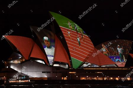 A projection of Cathy Freeman is displayed on the Sydney Opera House in Sydney, Australia, 25 September 2020. Vision of the Cathy Freeman's 400-metre gold medal run at the 2000 Olympics has been projected onto the Sydney Opera House sails in honor of the 20th anniversary of her win.