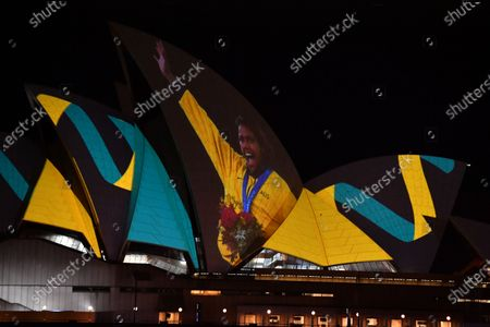 Stock Picture of A projection of Cathy Freeman is displayed on the Sydney Opera House in Sydney, Australia, 25 September 2020. Vision of the Cathy Freeman's 400-metre gold medal run at the 2000 Olympics has been projected onto the Sydney Opera House sails in honor of the 20th anniversary of her win.