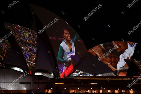 Stock Image of A projection of Cathy Freeman is displayed on the Sydney Opera House in Sydney, Australia, 25 September 2020. Vision of the Cathy Freeman's 400-metre gold medal run at the 2000 Olympics has been projected onto the Sydney Opera House sails in honor of the 20th anniversary of her win.