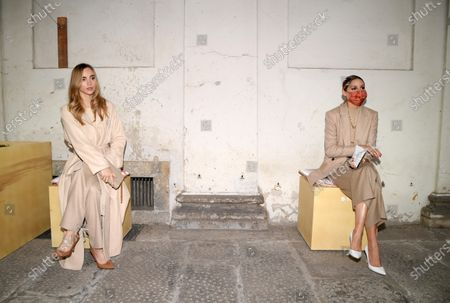 Stock Image of Suki Waterhouse and Olivia Palermo socially distanced in the front row