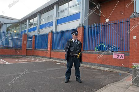 Police officer on guard outside the centre. A murder investigation has been launched by police after the death of a police officer at the Croydon Custody Centre in South London. The police officer was taken to hospital after being shot but sadly died.