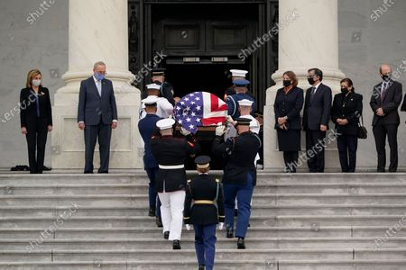 The flag-draped casket of Justice Ruth Bader Ginsburg is carried by a joint services military honor guard to lie in state at the U.S. Capitol, in Washington