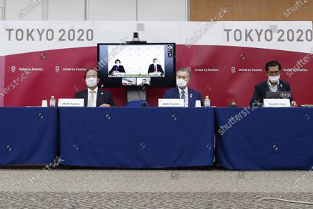 Left to right; Toshiro Muto CEO of Tokyo 2020, Yoshiro Mori President of Tokyo 2020 and Masa Takaya Spokesperson of Tokyo 2020, with Christophe Dubi IOC's Olympic Games Executive Director and Robert Roxburgh Head of Olympic Games Communications of IOC (on the screen), attenda joint press conference between the International Olympic Committee (IOC) and Tokyo Organizing Committee of the Olympic and Paralympic Games (Tokyo 2020), in Tokyo