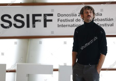 Raul Arevalo poses for the photographers during the presentation of the TV series 'Antidisturbios' in the framework of the 68th San Sebastian International Film Festival, at Kursaal Auditorium courtyard in Basque Country, northern Spain, 25 September 2020. The festival runs until 26 September.