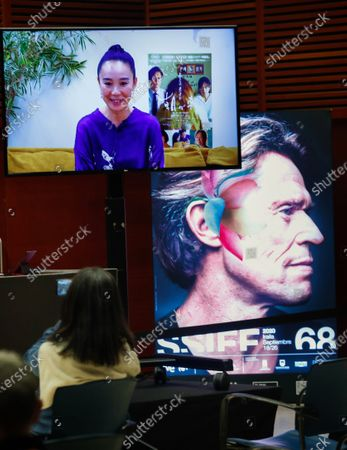 Naomi Kawase on a screen during a video-press conference on her movie 'Asa Ga Kuru' at the 68th annual San Sebastian International Film Festival (SSIFF), in San Sebastian, Spain, 25 September 2020. The film festival runs from 18 to 26 September 2020 under safety measures like obligatory face mask use and red carpets without public due to the Covid-19 coronavirus pandemic. Organizers have also reduced the number of film screenings as well as the seating capacity in cinemas.