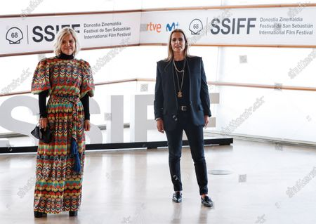 Tous jewelry brand Art Director, Marta Tous (R), and personality Eugenia Martinez de Irujo pose for the photographers during the presentation of the documentary 'OSO' (Bear) on the history of jewelry brand Tous, at the 68th annual San Sebastian International Film Festival (SSIFF), in San Sebastian, Spain, 25 September 2020. The film festival runs from 18 to 26 September 2020 under safety measures like obligatory face mask use and red carpets without public due to the Covid-19 coronavirus pandemic. Organizers have also reduced the number of film screenings as well as the seating capacity in cinemas.