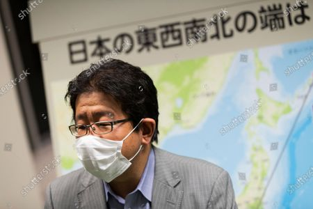 Kohei Saito, senior coordinator of the Cabinet Secretariat's Office of Policy Planning and Coordination on Territory and Sovereignty, sitting in front of a map of Japan, speaks during an interview with The Associated Press after a media tour at the National Museum of Territory and Sovereignty in Tokyo on . The tour also jointly organized by Japan's foreign ministry was about the history and features of disputed islands which are called Diaoyu by China and Senkaku by Japan
