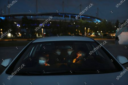 Family members in a car watch a drive-in circus from a parking lot in Seoul, South Korea, . The circus's aim is to provide entertainment for people during the coronavirus outbreak