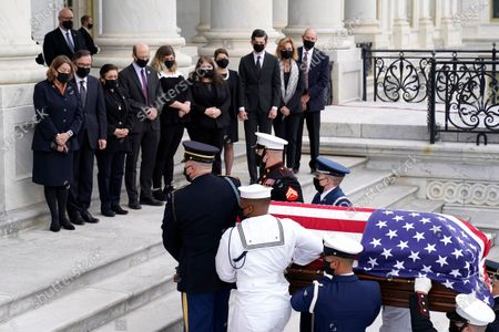 Family members watch as the flag-draped casket of Justice Ruth Bader Ginsburg is carried by a joint services military honor guard to lie in state at the U.S. Capitol, in Washington
