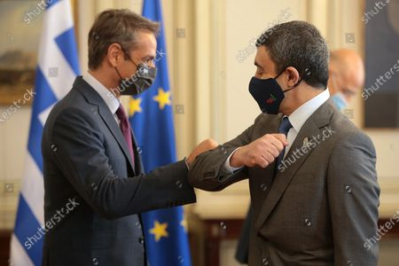 Greek Prime Minister Kyriakos Mitsotakis (L) greets UAE Foreign Affairs Minister Sheikh Abdullah bin Zayed bin Sultan Al Nahyan (R) during their meeting in Athens, Greece, 25 September 2020. The talks will focus on enhancement of bilateral cooperation and on regional issues, with emphasis on current developments in the Eastern Mediterranean and the Middle East, energy cooperation, and EU-UAE relations.