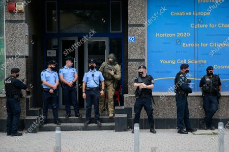 Stock Picture of Kosovo police guard the entrance of the offices of a war veterans association in Kosovo, in Pristina, . Witnesses say European Union security police have stormed the offices of a war veterans association in Kosovo. The association represents the former ethnic Albanian separatists who fought Serbian troops in a 1998-1999 war for independence. Members of the group said police from the European Union Rule of Law Mission in Kosovo, or EULEX, prevented them from going into the association's offices in Pristina on Friday