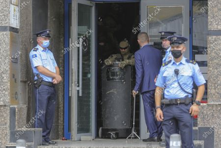 Kosovo police guard the entrance of the offices of a war veterans association in Kosovo, in Pristina, . Witnesses say European Union security police have stormed the offices of a war veterans association in Kosovo. The association represents the former ethnic Albanian separatists who fought Serbian troops in a 1998-1999 war for independence. Members of the group said police from the European Union Rule of Law Mission in Kosovo, or EULEX, prevented them from going into the association's offices in Pristina on Friday