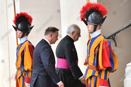 Polish President Andrzej Duda (2-L) arrives in the courtyard of St. Damasius at the Vatican City 25 September 2020. Pope Francis received the Polish President Andrzej Duda and his wife Agata Kornhauser-Duda in a private audience.