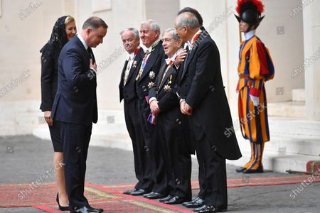 Polish President Andrzej Duda (2-L) and his wife Agata Kornhauser-Duda (L) arrive in the courtyard of St. Damasius at the Vatican City 25 September 2020. Pope Francis received the Polish President Andrzej Duda and his wife Agata Kornhauser-Duda in a private audience.