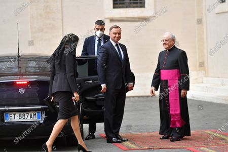 Polish President Andrzej Duda (3-L) and his wife Agata Kornhauser-Duda (L) arrive in the courtyard of St. Damasius at the Vatican City 25 September 2020. Pope Francis received the Polish President Andrzej Duda and his wife Agata Kornhauser-Duda in a private audience.