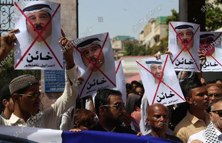 Supporters of Palestine foundation hold portraits of UAE Crown Prince Mohammad Bin Zayed and King of Bahrain Hamad bin Isa bin Salman Al Khalifa as they shout slogans during a protest against normalization of diplomatic relationship between UAE, Israel and Bahrain in Karachi, Pakistan, 25 September 2020. Many are against the agreement between the UAE, Israel and Bahrain as they consider it breaks a consensus between Arab countries not to formalize diplomatic relations with Israel before the establishment of the Palestinian state