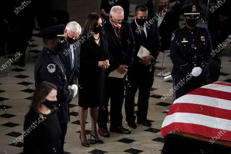 House Majority Leader Steny Hoyer, of Md., Democratic vice presidential candidate Sen. Kamala Harris, D-Calif., House Minority Whip Steve Scalise, R-La., and Rep. Ben Lujan, D-N.M., pay respects at the flag-draped casket of Justice Ruth Bader Ginsburg lying in state in Statuary Hall of the U.S. Capitol, in Washington. Ginsburg died at the age of 87 on Sept. 18 and is the first women to lie in state at the Capitol