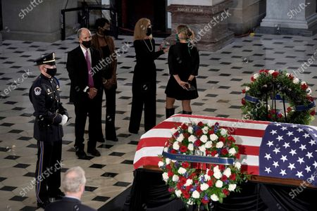 Democratic National Committee chair Tom Perez pays respects at the flag-draped casket of Justice Ruth Bader Ginsburg lying in state in Statuary Hall of the U.S. Capitol, in Washington. Ginsburg died at the age of 87 on Sept. 18 and is the first women to lie in state at the Capitol