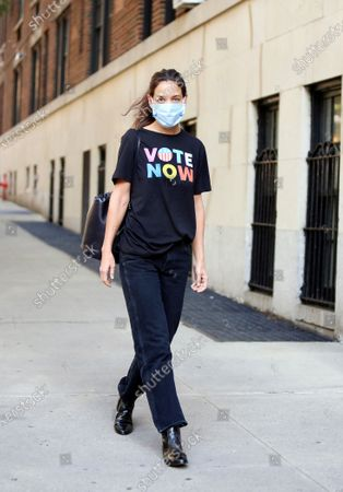 Katie Holmes rocks an Old Navy VOTE tee shirt following the brand's commitment to pay their their employees to Power the Polls, an initiative to ignite voting