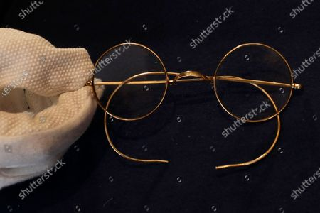Pair of round Windsor spectacles that belonged to John Lennon are displayed at Sotheby's auction rooms in London, . The glasses are estimated at 30,000-40,000 UK pounds (38,155-50,873 US dollars). This month Sotheby's will host a sale celebrating arguably the most influential band of all time: the Beatles, this sale will offer a fascinating array of objects spanning the entirety of the Beatles' performing career. With over sixty lots with estimates ranging from 500 to 40,000, UK pounds this sale offers fans and collectors old and new the chance to acquire a piece of pop culture history