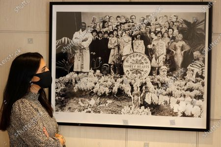 Stock Picture of Sgt Pepper's Lonely Hearts Club Band, 1967, silver print 1/25 is displayed at Sotheby's auction rooms in London, . The photograph is estimated at 7,000-10,000 UK pounds (8,709- 12,442 US dollars). This month Sotheby's will host a sale celebrating arguably the most influential band of all time: the Beatles, this sale will offer a fascinating array of objects spanning the entirety of the Beatles' performing career. With over sixty lots with estimates ranging from 500 to 40,000, UK pounds this sale offers fans and collectors old and new the chance to acquire a piece of pop culture history