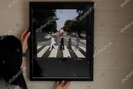 An Iain Macmillan chromogenic print of the Beatles, Abbey Road Outtakes, 1969, signed and numbered is displayed at Sotheby's auction rooms in London, . The photograph is estimated at 7,000-10,000 UK pounds (8,709- 12,442 US dollars)This month Sotheby's will host a sale celebrating arguably the most influential band of all time: the Beatles, this sale will offer a fascinating array of objects spanning the entirety of the Beatles' performing career. With over sixty lots with estimates ranging from 500 to 40,000, UK pounds this sale offers fans and collectors old and new the chance to acquire a piece of pop culture history