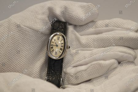 Cartier wristwatch,1966, owned by Beatles manager Brian Epstein is displayed at Sotheby's auction rooms in London, . The watch is estimated at 15,000-20,000 UK pounds (18,663-24,884 US dollars)This month Sotheby's will host a sale celebrating arguably the most influential band of all time: the Beatles, this sale will offer a fascinating array of objects spanning the entirety of the Beatles' performing career. With over sixty lots with estimates ranging from 500 to 40,000, UK pounds this sale offers fans and collectors old and new the chance to acquire a piece of pop culture history