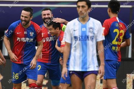 Gao Xiang (3rd L) of Qingdao Huanghai celebrates scoring with teammates during the 13th round match between Qingdao Huanghai and Tianjin Taida at the postponed 2020 season Chinese Football Association Super League (CSL) Suzhou Division in Suzhou, east China's Jiangsu Province, Sept. 25, 2020.