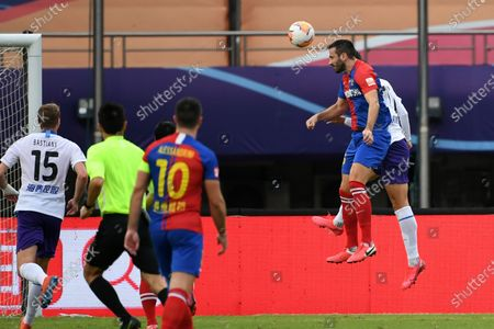 Vukovic (Top front) of Qingdao Huanghai heads for the ball during the 13th round match between Qingdao Huanghai and Tianjin Taida at the postponed 2020 season Chinese Football Association Super League (CSL) Suzhou Division in Suzhou, east China's Jiangsu Province, Sept. 25, 2020.