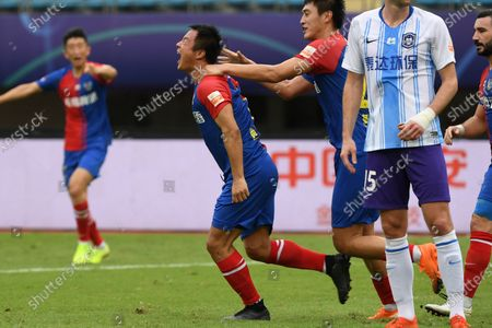 Gao Xiang (2nd L) of Qingdao Huanghai celebrates scoring with teammates during the 13th round match between Qingdao Huanghai and Tianjin Taida at the postponed 2020 season Chinese Football Association Super League (CSL) Suzhou Division in Suzhou, east China's Jiangsu Province, Sept. 25, 2020.