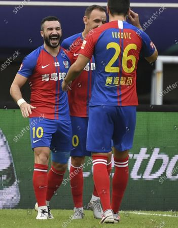 Alessandrini (L) of Qingdao Huanghai celebrates scoring with teammates during the 13th round match between Qingdao Huanghai and Tianjin Taida at the postponed 2020 season Chinese Football Association Super League (CSL) Suzhou Division in Suzhou, east China's Jiangsu Province, Sept. 25, 2020.