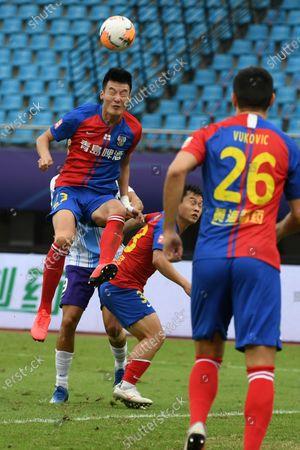 Stock Image of Liu Jiashen (L) of Qingdao Huanghai vies for the ball during the 13th round match between Qingdao Huanghai and Tianjin Taida at the postponed 2020 season Chinese Football Association Super League (CSL) Suzhou Division in Suzhou, east China's Jiangsu Province, Sept. 25, 2020.